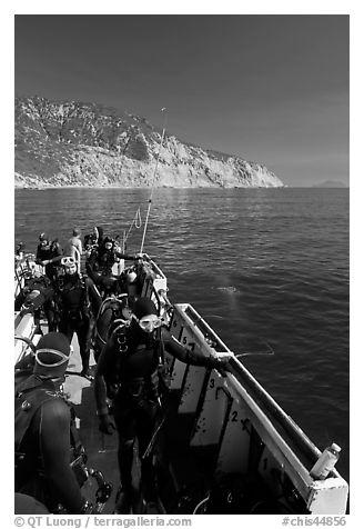 Divers in full wetsuits on diving boat, Santa Cruz Island. Channel Islands National Park (black and white)