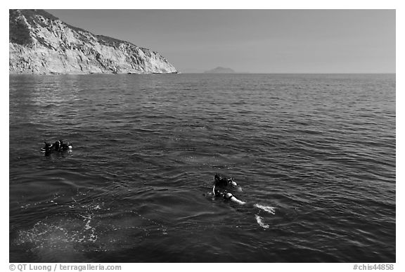 Scuba divers on ocean surface, Santa Cruz Island. Channel Islands National Park (black and white)