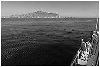 Woman on boat cruising towards Annacapa Island. Channel Islands National Park, California, USA. (black and white)