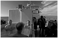 Soaking in hot tub on diving boat, Annacapa Island. Channel Islands National Park, California, USA. (black and white)