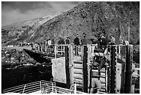 Unloading via human chain, Scorpion Anchorage, Santa Cruz Island. Channel Islands National Park ( black and white)