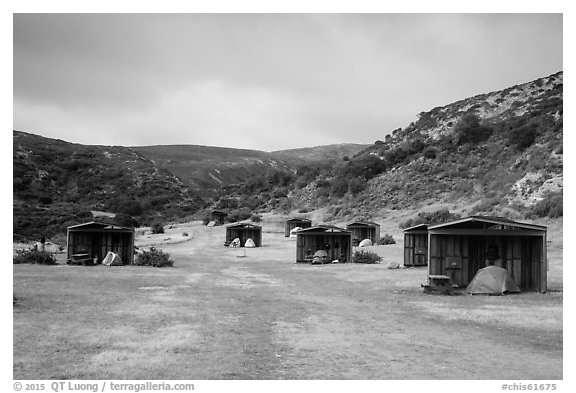 Tents pitched in wind shelters, Santa Rosa Island. Channel Islands National Park (black and white)