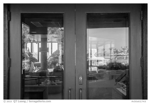 Ventura Harbor visitor center window reflexion. Channel Islands National Park (black and white)