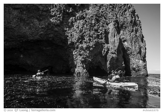 Kayaking towards sea cave, Santa Cruz Island. Channel Islands National Park (black and white)