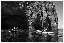 Kayaking towards sea cave, Santa Cruz Island. Channel Islands National Park ( black and white)
