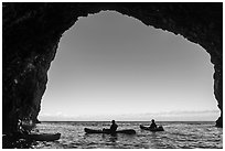 Looking out sea cave with group of kayakers, Santa Cruz Island. Channel Islands National Park ( black and white)