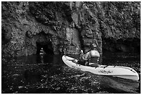 Kayakers entering sea cave, Santa Cruz Island. Channel Islands National Park ( black and white)