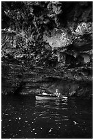 Kayaker in sea cave with low ceiling, Santa Cruz Island. Channel Islands National Park ( black and white)