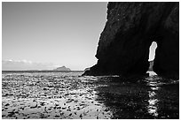 Sea arch, West Anacapa in the distance, Santa Cruz Island. Channel Islands National Park ( black and white)