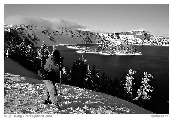 Photographer on  rim of  Lake in winter. Crater Lake National Park (black and white)