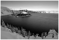 Wizard Island and lake in late afternoon shade, winter. Crater Lake National Park, Oregon, USA. (black and white)