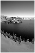 Wizard Island and lake in winter, late afternoon. Crater Lake National Park, Oregon, USA. (black and white)