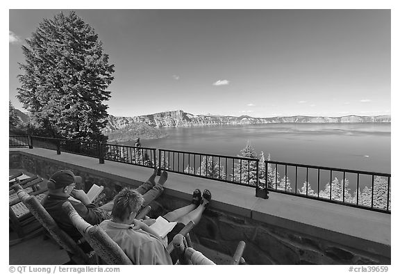 Reading on Crater Lake Lodge Terrace overlooking  Lake. Crater Lake National Park (black and white)