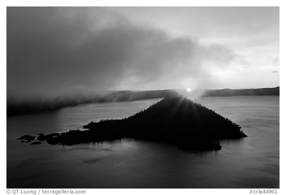 Sun rising behind Wizard Island. Crater Lake National Park (black and white)