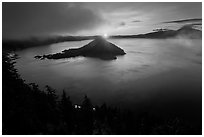 Wide view with sunrise and clouds. Crater Lake National Park, Oregon, USA. (black and white)