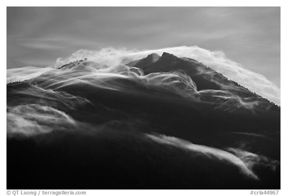 Cloudcap over backlit Mt Scott summit. Crater Lake National Park (black and white)
