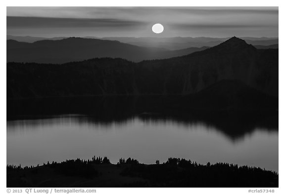 Sun setting over Crater Lake and Llao Rock. Crater Lake National Park (black and white)