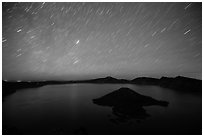Star trails over Crater Lake and Wizard Island. Crater Lake National Park ( black and white)