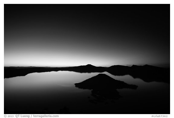 Wide view of lake with dawn on eastern horizon. Crater Lake National Park (black and white)