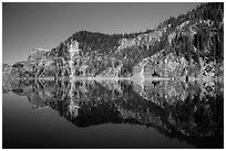 Cliffs reflected in calm waters. Crater Lake National Park ( black and white)
