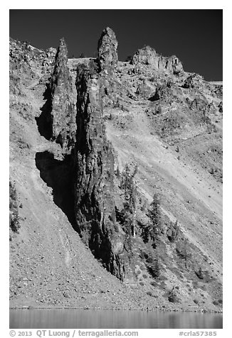 Devils Backbone, vertical dike of dark andesite lining the cliff face. Crater Lake National Park (black and white)