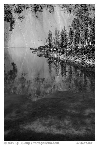 Watchman reflection in clear water of Fumarole Bay, Wizard Island. Crater Lake National Park (black and white)