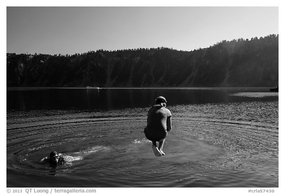 Girl jumps in water in Governors Bay, Wizard Island. Crater Lake National Park (black and white)