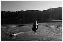 Girl jumps in water in Governors Bay, Wizard Island. Crater Lake National Park ( black and white)
