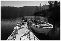 Visitors embark on tour boat at Wizard Island boat dock. Crater Lake National Park ( black and white)