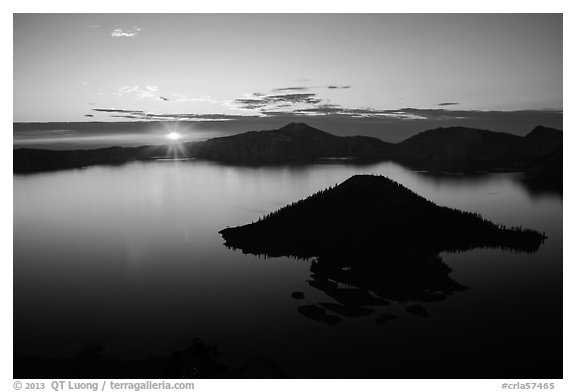Sun rising below cloud band. Crater Lake National Park (black and white)
