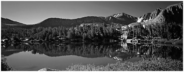 Clear lake with mountain range reflected. Kings Canyon National Park (Panoramic black and white)