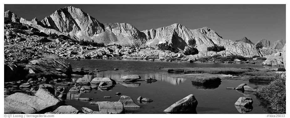 High Sierra peaks reflected in blue alpine lake. Kings Canyon National Park (black and white)