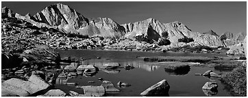 High Sierra peaks reflected in blue alpine lake. Kings Canyon National Park (Panoramic black and white)