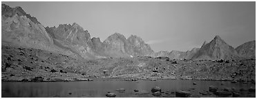 Pink light on High Sierra and lake at twilight. Kings Canyon National Park (Panoramic black and white)