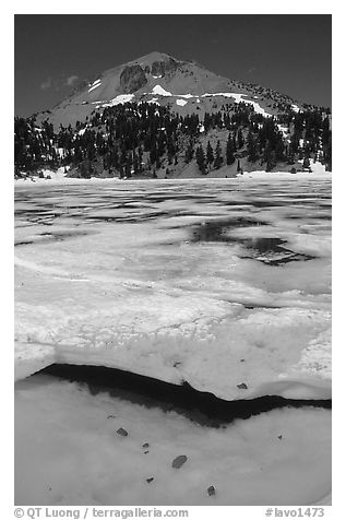 Ice break up in lake Helen and Lassen Peak, early summer. Lassen Volcanic National Park (black and white)
