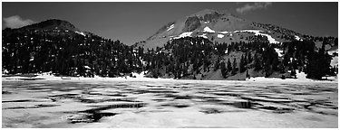Melting ice in lake and Lassen Peak. Lassen Volcanic National Park (Panoramic black and white)