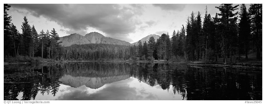Volcanic peak and conifer reflected in lake. Lassen Volcanic National Park (black and white)