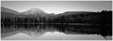 Lassen Peak reflected in Manzanita lake at sunset. Lassen Volcanic National Park (Panoramic black and white)