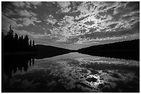 Moonlit clouds over Juniper Lake at night. Lassen Volcanic National Park ( black and white)