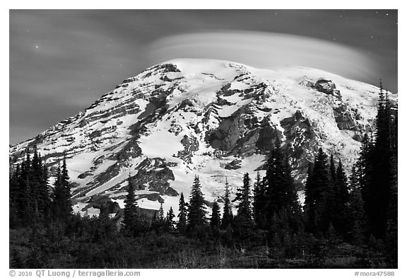 Mount Rainier capped by lenticular cloud, night. Mount Rainier National Park (black and white)