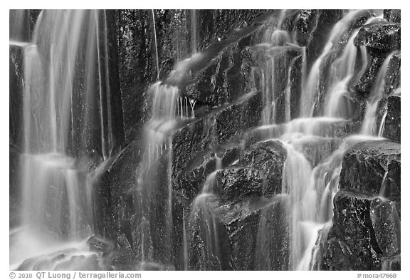 Waterfall over columns of cooled lava. Mount Rainier National Park (black and white)