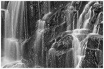 Waterfall over columns of cooled lava. Mount Rainier National Park ( black and white)
