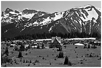 Meadows, buildings and parking lot, mountains, Sunrise. Mount Rainier National Park, Washington, USA. (black and white)