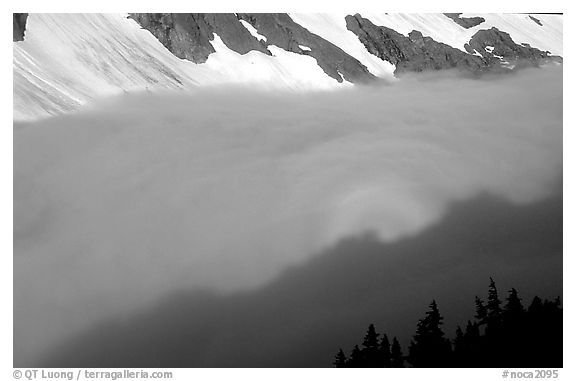 Sun projected on clouds filling Cascade River Valley,.  (black and white)