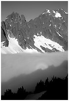 Peaks above fog-filled Cascade River Valley, early morning, North Cascades National Park. Washington, USA. (black and white)