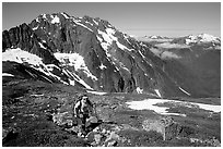 Mountaineer hiking on the way to Sahale Peak,  North Cascades National Park. Washington, USA. (black and white)
