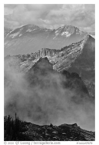 Peaks partly obscured by clouds, North Cascades National Park.  (black and white)