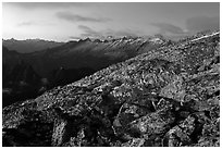 Rocky slope and distant range at dusk, North Cascades National Park.  ( black and white)