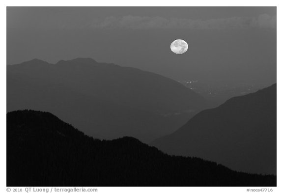 Moon setting over ridges, North Cascades National Park.  (black and white)
