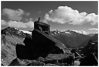 Man sitting on rock photographs mountain panorama, North Cascades National Park.  ( black and white)
